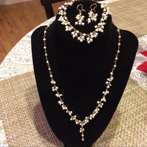 Pearl necklace, earrings and bracelet set. $350